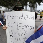 Cuban journalist held after police dog attack story