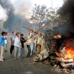 Gujarat violence shadows India's Modi