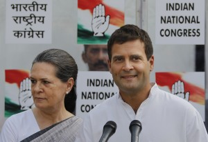 Congress party Vice President Rahul Gandhi addresses the media, as his mother and party President Sonia Gandhi stands by his side outside the party headquarters in New  Delhi, India, Friday, May 16, 2014. In a campaign led by Rahul Gandhi, the son, grandson, and great-grandson of Indian prime ministers, the Indian National Congress party suffered the most crushing defeat in its 128-year history Friday as the results of India's general election were released. (AP Photo/Altaf Qadri)