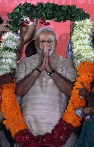India's next prime minister and Hindu nationalist Bharatiya Janata Party (BJP) leader Narendra Modi receives a garland during a rally in Ahmadabad, India, Tuesday, May 20, 2014.  (AP Photo/Ajit Solanki)