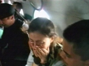 Hostage Ingrid Betancourt reacts as she rides in a helicopter during a Colombian military mission that rescued her from captivity in an unknown location in Colombia's Guaviare state.   (AP Photo/Colombian Army)