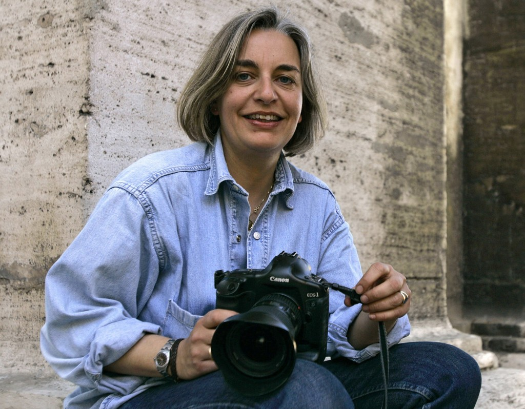 In this April 7, 2005 file photo, Associated Press photographer Anja Niedringhaus poses in Rome. Photo credit: AP Photo/Peter Dejong,
