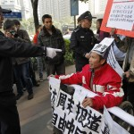 China media activist charged for 2013 protest