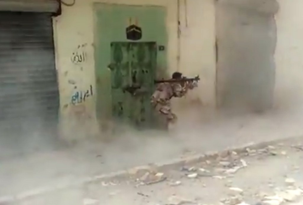 This May 29, 2013 file image made from video posted by Shaam News Network, which is consistent with other AP reporting, shows a Free Syrian Army fighter firing a rocket propelled grenade in Aleppo, Syria, targeting a Syrian regime stronghold. (AP Photo/Shaam News Network via AP video)