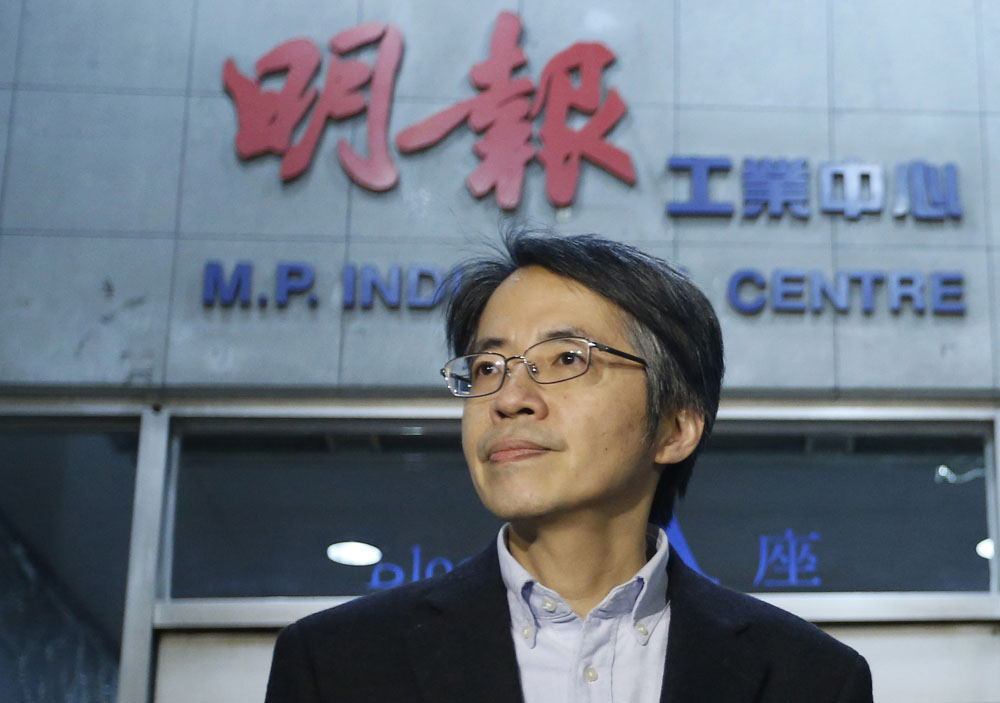"In this January 13, 2014 photo, former Ming Pao chief editor Kevin Lau Chun-to is seen outside his office building in Hong Kong. The former editor of a Hong Kong newspaper whose abrupt dismissal in January sparked protests over press freedom has been stabbed, police said on Wednesday. Police said a man wearing a motorcycle helmet ""suddenly"" attacked Kevin Lau on Wednesday morning with a knife and then fled on a motorcycle driven by another man.  (AP Photo/Str)"