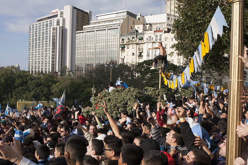 Almost 20,000 soccer fans flocked to Plaza San Martin to watch Argentina play in the World Cup finals on Sunday, July 13, 2014. It soon became a crowd crush, with soccer fans climbing onto lamp posts, trees and each other to see the game. (Photo/Brittany Crocker)