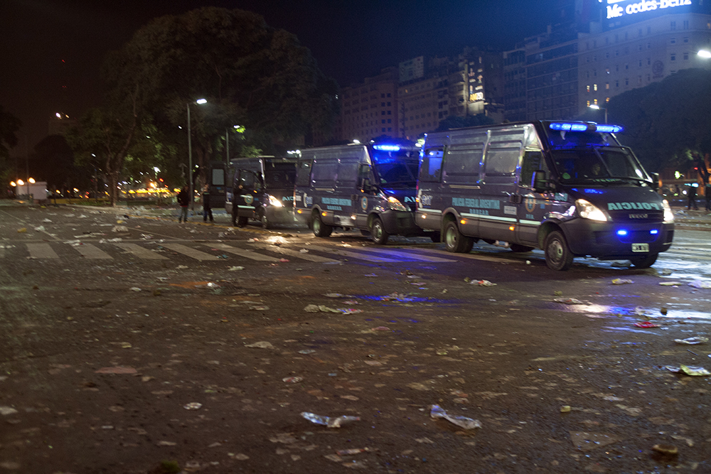 Police transport vehicles line Avenedia 9 de Julio after the World Cup riots to take away detainees. (Photo/Brittany Crocker)