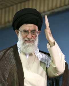 Iranian supreme leader Ayatollah Ali Khamenei waves to the crowd during during a ceremony to commemorate a revered Shiite saint, in Tehran, July 6, 2009. (AP Photo/Office of the Supreme Leader)