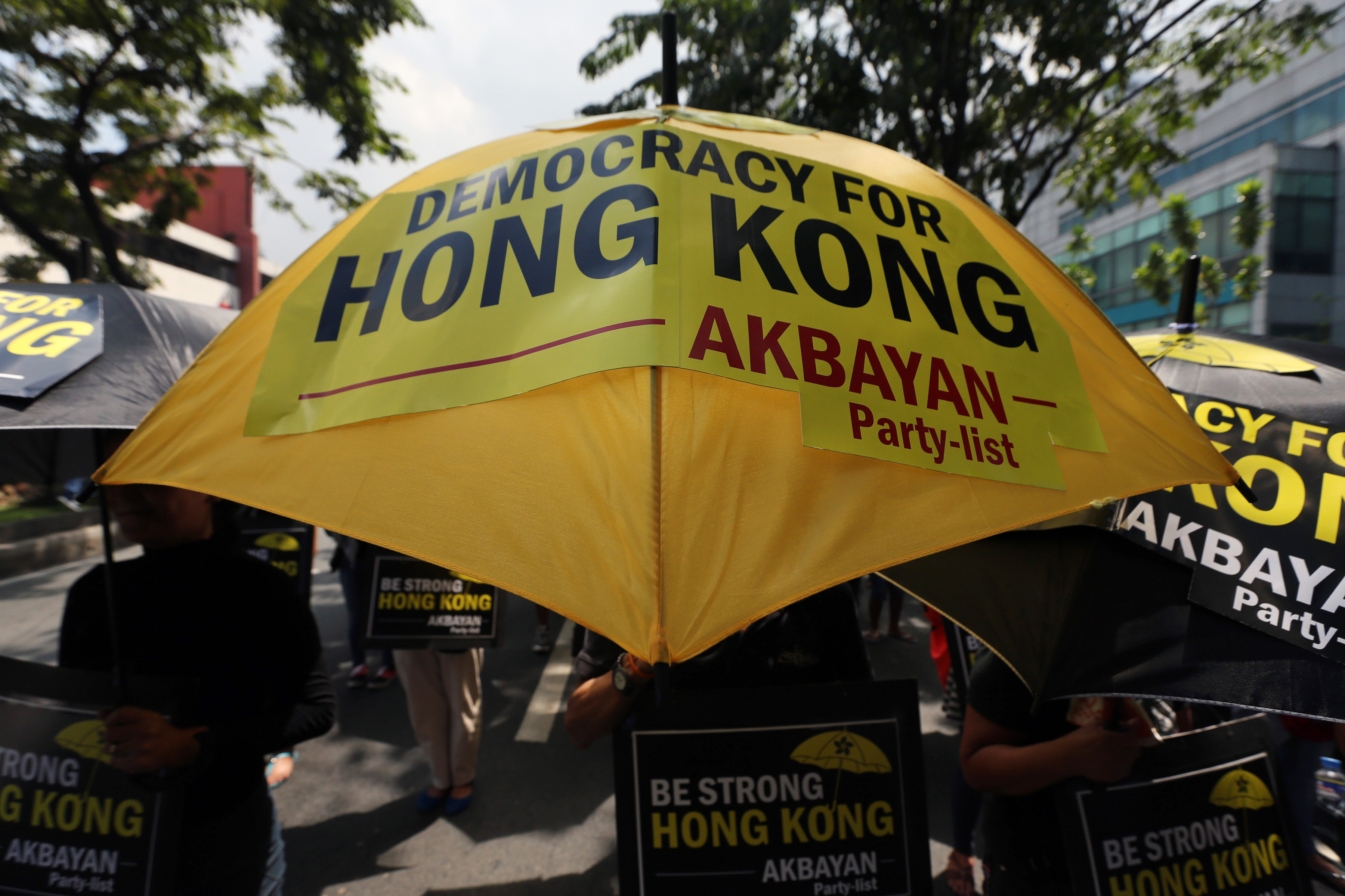 Filipinos holding umbrellas stage a demonstration to express their solidarity with Hong Kong's pro-democracy protesters in front of the Chinese Consulate in Makati city, south of Manila, Philippines, 02 October 2014. Photo credit: EPA/FRANCIS R. MALASIG