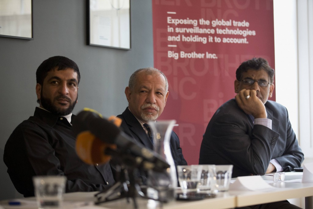 Pro-democracy activists, from left, Moosa Abd-Ali Ali, Saeed Al-Shehabi and Jaafar Al Hasabi said they were hacked by Bahrain's government while living in Britain, one of a growing number of cases in which refugees say malicious software has been used to keep tabs on their activities abroad.  Pictured in October 2014, the three are at the heart of a criminal complaint alleging that Bahrain's government infected their computers with FinFisher, a powerful piece of espionage software.  (AP Photo/Matt Dunham)