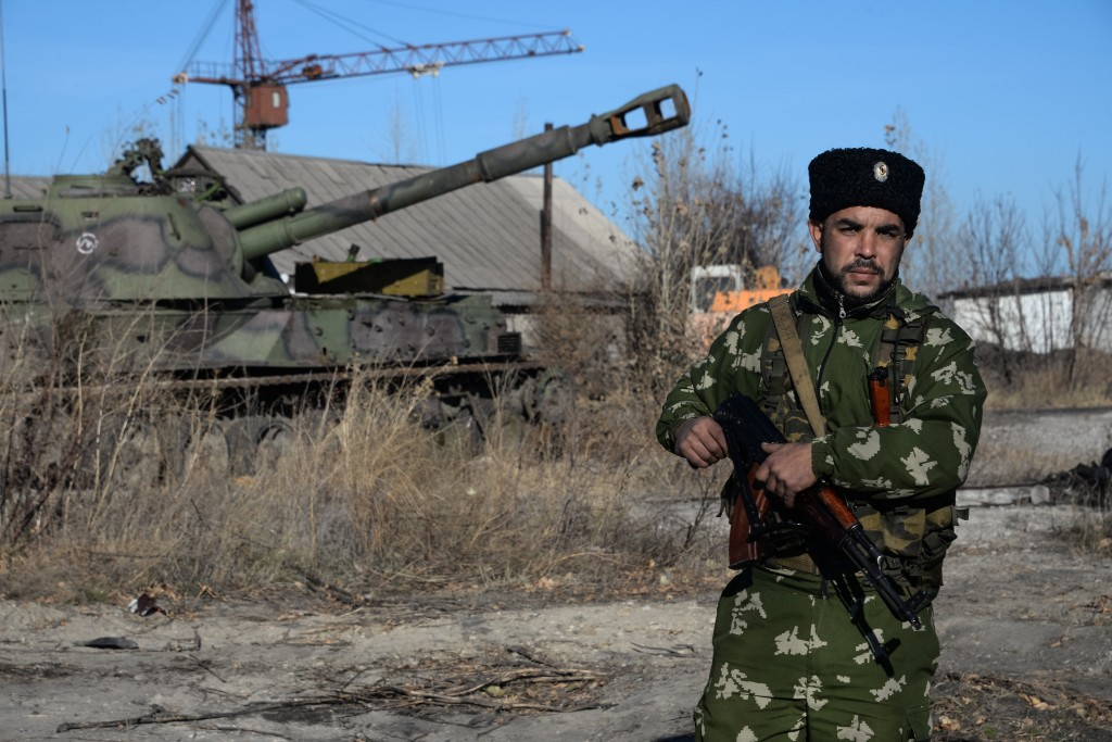 A Russian Cossack stands on guard at the military base in Perevalsk, Eastern Ukraine, Nov. 5, 2014.  (AP Photo/Mstyslav Chernov)