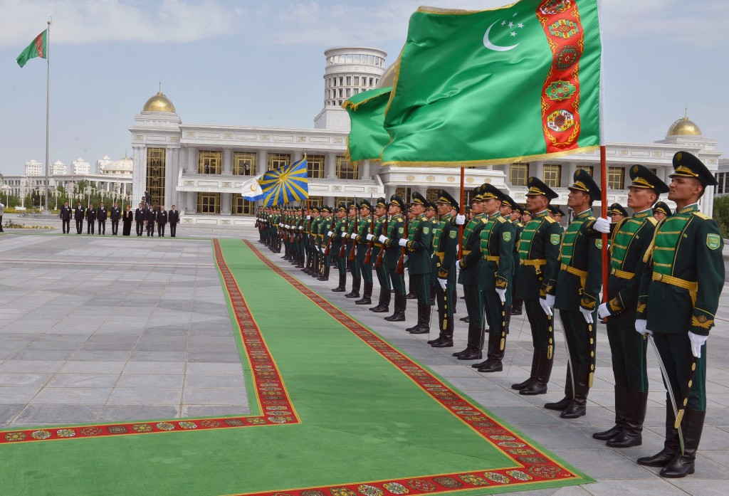Turkmen honor guard stand before the arrival of Turkish President Abdullah Gul and his Turkmen counterpart Gurbanguli Berdymukhamedov for a welcoming ceremony in Ashgabat, Turkmenistan, May 30, 2013. (AP Photo/Mehmet Demirci, Turkish Presidency Press Office, HO)
