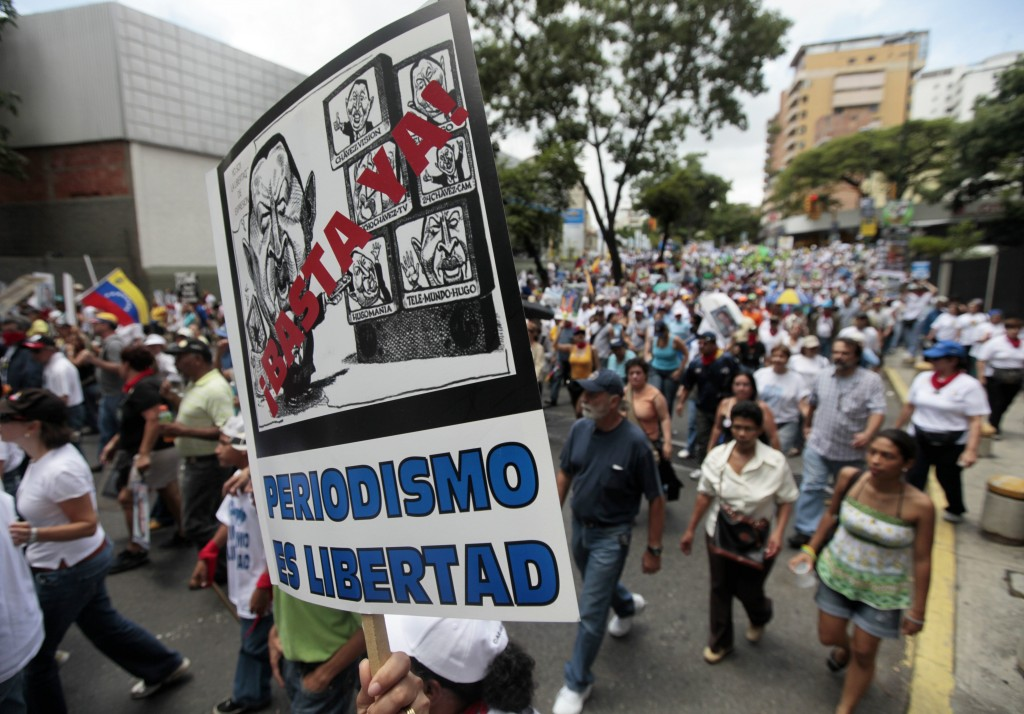 Supporters of Globovision march in opposition to regulatory measures against the channel in Caracas, June 27, 2009.  (AP Photo/Fernando Llano)