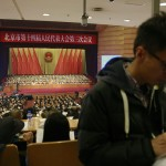 China tightens hold on Internet, reporters