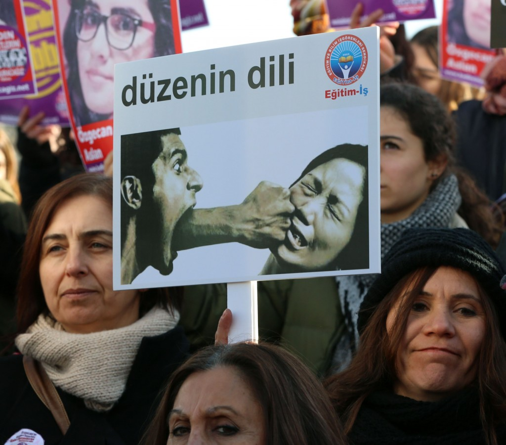 "Turkish women gather to protest Aslan's killing in the capital Ankara, Feb. 21, 2015. The caption on the placard reads: ""The language of the system."" (AP Photo/Burhan Ozbilici)"