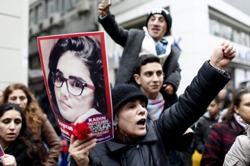Turkish people shout slogans against the murder of a woman as they hold a picture of Ozgecan Aslan who was raped and killed by three suspects in Mersin city, during a demonstration in Istanbul, Turkey, Feb. 14, 2015. (EPA/SEDAT SUNA)