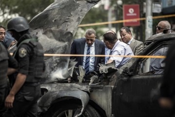 Security personnel investigate the site of a bombing that killed Egypt's top prosecutor, Hisham Barakat, in Cairo, Egypt, June 29, 2015.