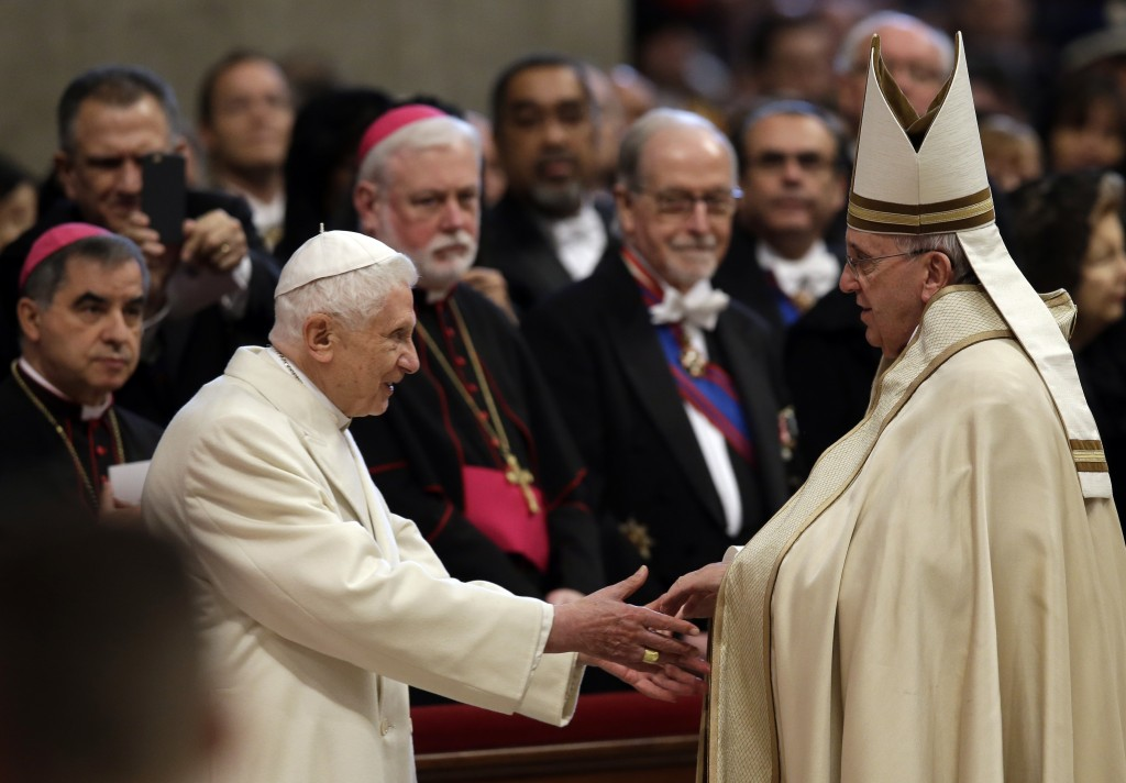 Pope Emeritus Benedict XVI, left, greets Pope Francis in St. Peter's Basilica Feb. 14, 2015. P (AP Photo/Andrew Medichini)