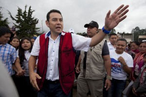 Presidential candidate Jimmy Morales of the National Front of Convergence party waves to supporters as he arrives to a campaign rally in Chichicastenango, Guatemala, Oct. 17, 2015. (AP Photo/Moises Castillo)