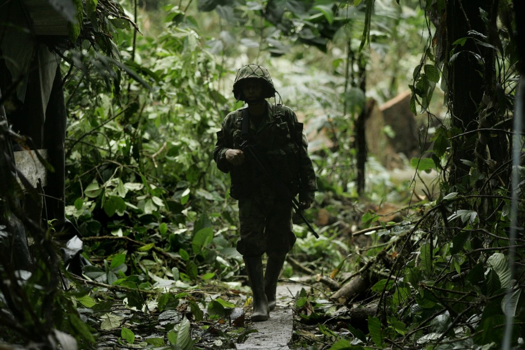 A Colombian soldier walks through a clandestine cocaine laboratory seized from the FARC in March 2010. (AP Photo/Christian Escobar Mora)