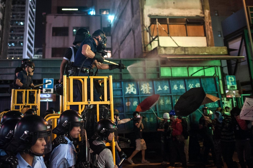 Riot police use tear spray during clash with protesters at Mongkok district on November 25, 2014 in Hong Kong.