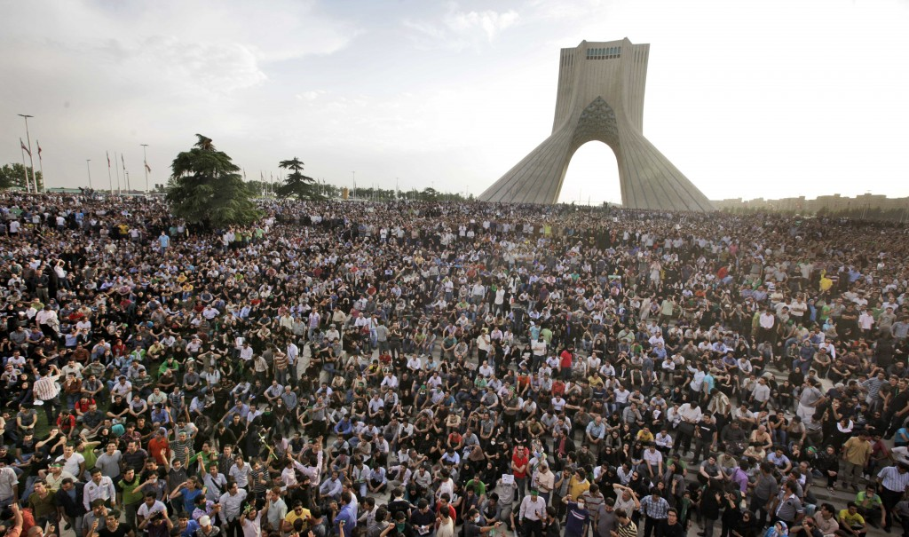 Hundreds of thousands of supporters of Iranian opposition presidential candidate Mir Hossein Mousavi protest voting fraud after the country's disputed election. June 15, 2009. (AP Photo/Ben Curtis)
