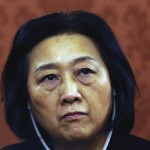 China bars ailing journalist from travel