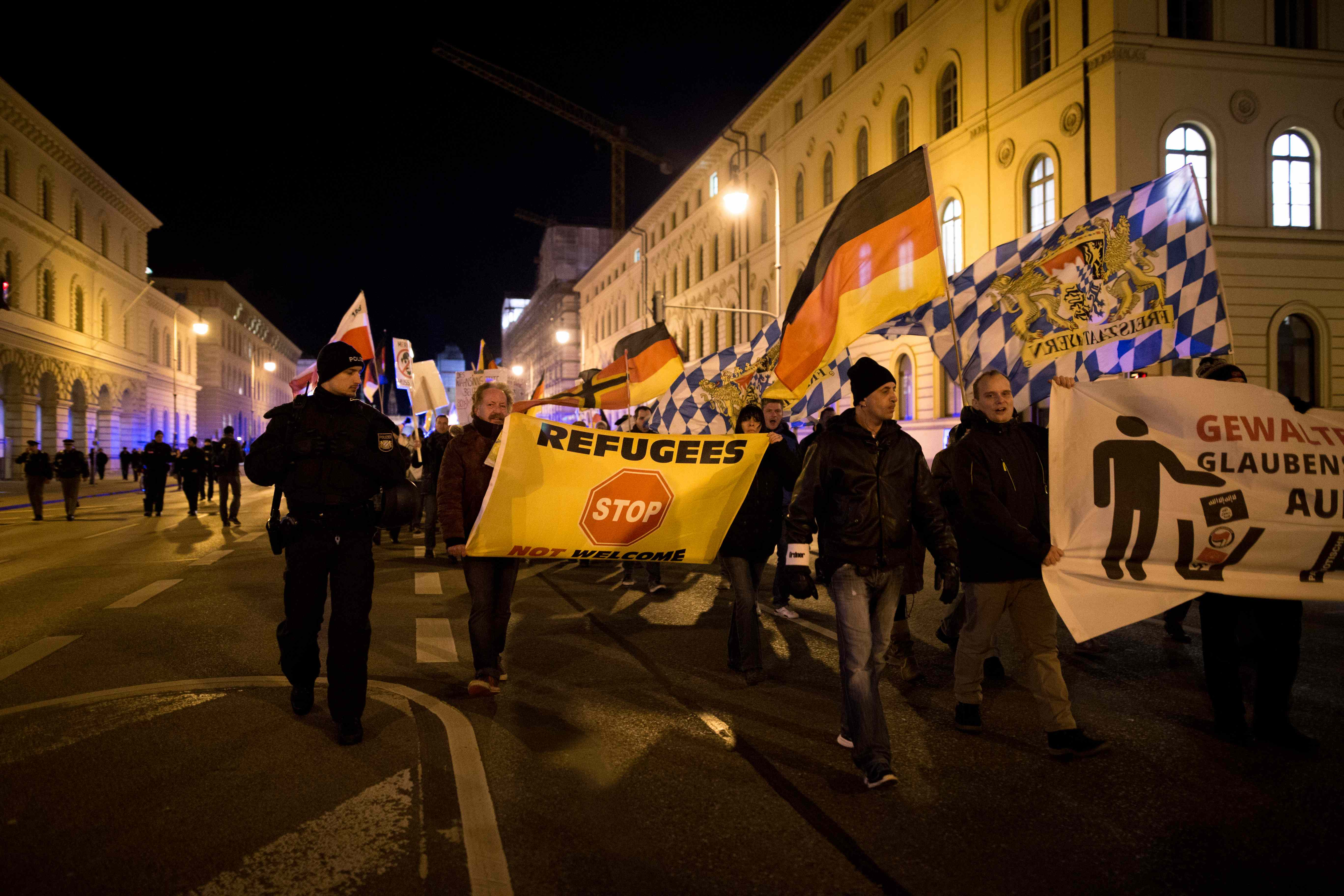 "Pegida demonstrators hold a banner reading ""Refugees not welcome"" during a march in Munich (Michael Tranmer/24mm Journalism)."