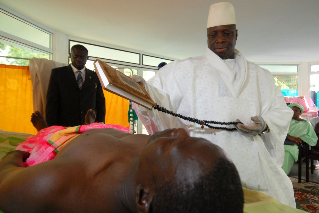 Gambia's President Yahya Jammeh, prays while administering his alleged herbal HIV cure to a patient in Banjul, Gambia,  Feb. 15, 2007. (AP/Photo Candace Feit)