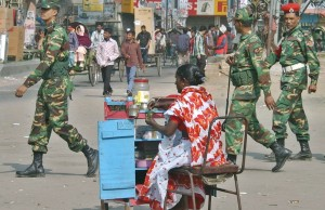 Bangladeshi army soldiers patrol the streets in Dhaka, Bangladesh, Friday, Jan. 12, 2007. Soldiers arrested an opposition politician Friday in a pre-dawn raid, one day after the president declared a nationwide state of emergency and postponed upcoming elections after weeks of often-violent protests.(AP Photo/Pavel Rahman)