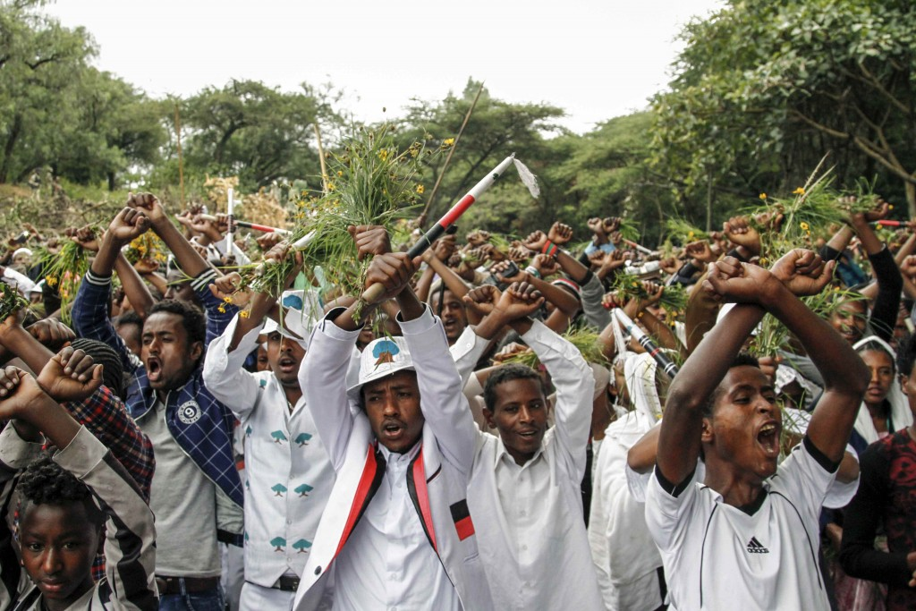 Ethiopians chant slogans against the government during their march in Bishoftu, Ethiopia, Oct. 2, 2016. Protests in Ethiopia's Oromia region in 2016 were sparked by unrest over a plan to expand the capital Addis Ababa into the Oromia regional state. (AP Photo)