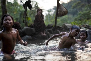 Ashaninka Indian children wade in the natural hot springs in Kitamaronkani, Pichari district, Peru in 2013. (AP Photo/Rodrigo Abd)
