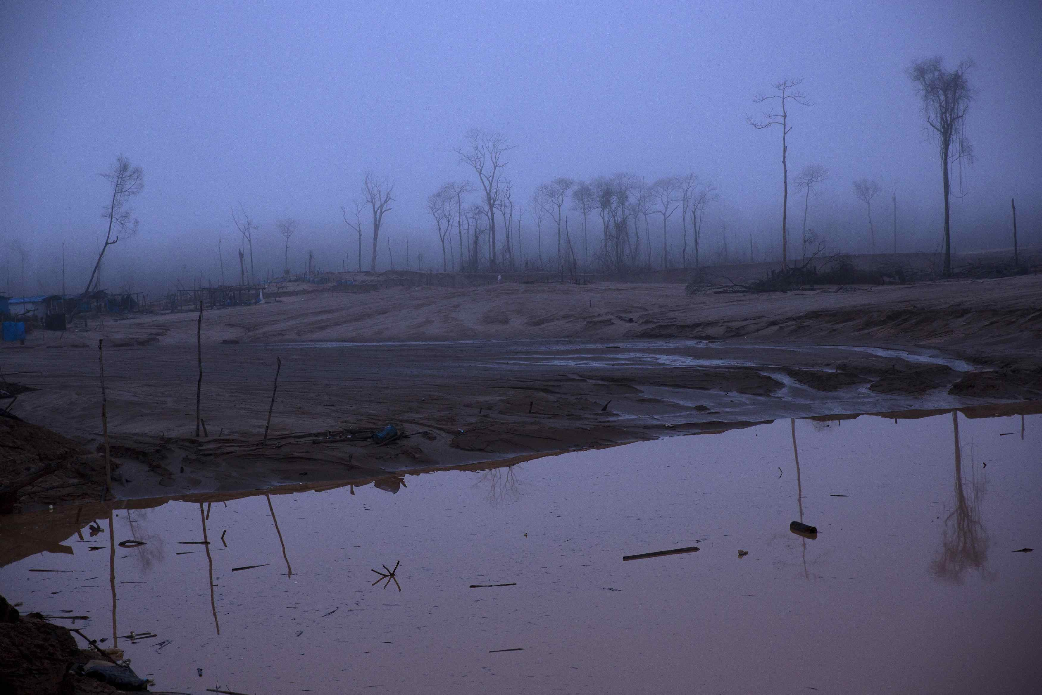 A 2016 photo of Peru's Madre de Dios region shows the deforestation of once pristine rain forest by illegal gold miners. (AP Photo/Rodrigo Abd)