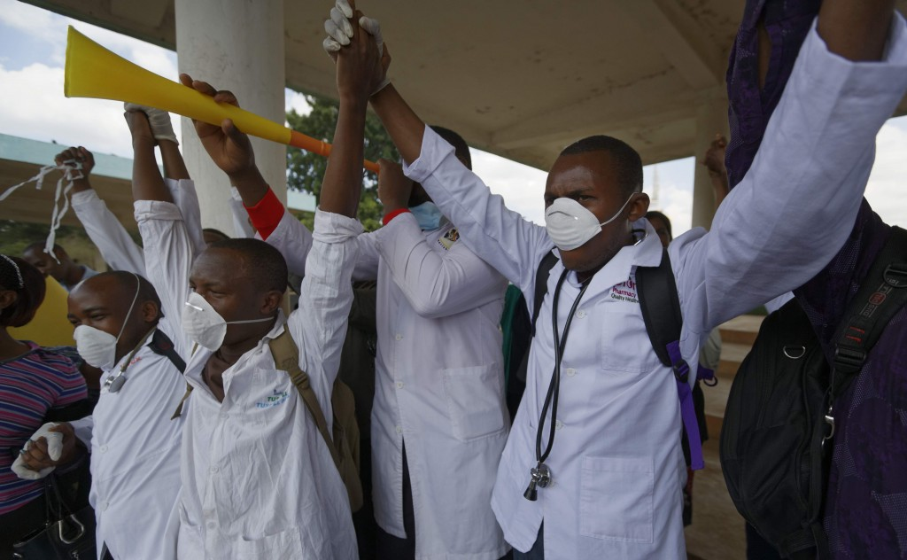 Kenyan nurses and other health-workers demonstrate over low pay at Uhuru Park in downtown Nairobi, Kenya, Dec. 8, 2016. (AP Photo/Ben Curtis)