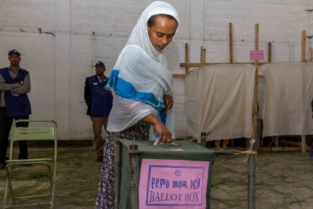 A woman casts her vote in Ethiopia's general election in Addis Ababa, Ethiopia, May 24, 2015. The ruling EPRDF won all 546 seats in parliament after a campaign opposition groups said was neither free nor fair. (AP Photo/Mulugeata Ayene)
